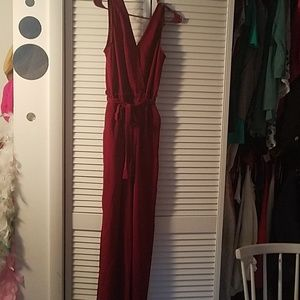 Maroon jumpsuit with pockets and tie waist